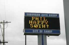 by: Marcus Hathcock, Electronic readerboards, such as this one at Suburban Auto Group, would be limited to public buildings if the council passes the sign code revisions.