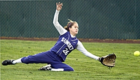 by: JAIME VALDEZ, GOT IT — Sunset right fielder Kristina Trindle makes a sliding catch in a non-league game against Tualatin last week at Tualatin High School.