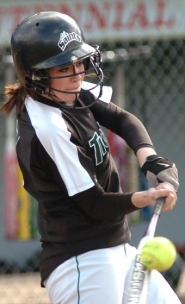 by: DAN BROOD, GOOD CONTACT — Tigard sophomore Katie Aden gets her bat on the ball in Friday's game.