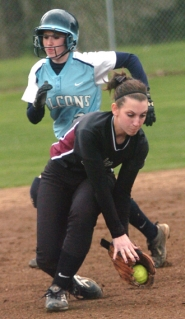 by: DAN BROOD, MAKING THE PLAY — Sherwood shortstop Alyssa Troccoli fields the ball in front of a Liberty runner.