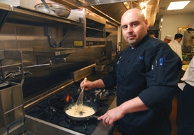 by: Vern Uyetake, Executive Chef Dan Uhl prepares a dish at the West Linn location of the Blue Sage Café. Located in the Central Village, Blue Sage offers American cuisine with a Southwest flair.