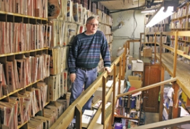 by: JIM CLARK, Cameron's owner Jeff Frase stands among the shelves in his downtown Portland store, where nostalgia junkies can get their fix of old Life magazines, among others.