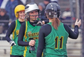 by: KATIE HARTLEY, Cleveland's Melaine Schoepp (No. 11) congratulates fellow Warriors Sarah (middle) and Kristin Breninger after scoring in a 12-0 victory over Lincoln last week. Cleveland won the PIL 5A last year.