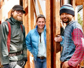 by: David F. Ashton, Daniel Barone and Daniel Sanchez from Green Building Construction take a brief break from framing, to point out the old and new lumber being used in Shannon Quimby's REX Project house.