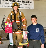 "by: David F. Ashton, Portland Fire & Rescue firefighter Marc Ham takes his turn on the stepping exerciser, as firefighter Tim Spring ""passes the boot"", asking shoppers for a donation to the Leukemia & Lymphoma Society."