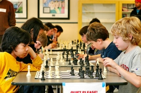 by: David F. Ashton, These young chess-masters don't wiggle or squirm while their game is in play – they appear to be completely focused on the chessboard.