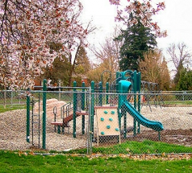 by: Rita A. Leonard, New green and tan playground equipment and climbing boulders are featured at Kenilworth Park in the Creston-Kenilworth neighborhood, just east of Grout Elementary School.