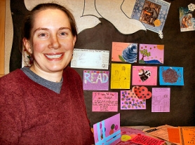 "by: Rita A. Leonard, Sellwood Branch Library volunteer Emily Carlson creates a display of local ""Mail Art"", currently posted on the bulletin board in the Children's Section."