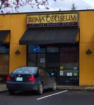 by: Erick Mertz, Pizza Roma has opened a sports bar next door, along Woodstock Boulevard; the new Roma Coluseum fills a local need.