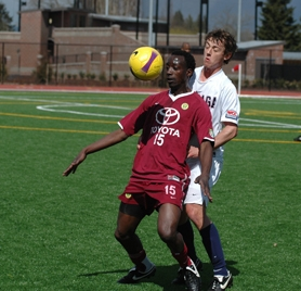 by: Chase Allgood, Gonzaga's Sean Connor applies some defensive pressure to Lawrence Olum of the Portland Timbers during Sunday's exhibition match at Lincoln Park Stadium in Forest Grove.