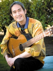 by: John Klicker, Toshi Onizuka grew up in Japan, but fell in love with Spanish culture through flamenco music. The 43-year-old guitarist has released a CD, toured Europe and will be among the highlights of the First Friday Art Walk in Troutdale this week.