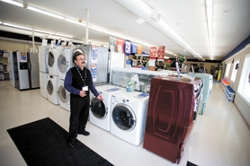 by: Chase Allgood, Rey Cantu shows off new energy-efficient washers and dryers at his new Sears franchise in Cornelius. The store is located on Baseline on the east end of Cornelius.
