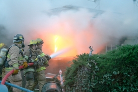 by: Columbia River Fire and Rescue, (L to R) Firefighters Bryan Reedy, Tom Moung and Jeff Lockhart battle back a morning blaze on Saturday in St. Helens, where Moung and Lockhart pulled a man to safety.