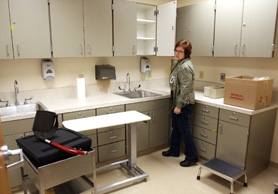 by: Jaime Valdez, A SHOT AT HEALTH – Tigard High Health Clinic family nurse practitioner Margaret Stochosky walks through the laboratory room as she and other workers prepare for the grand opening of the school-based health center next week.