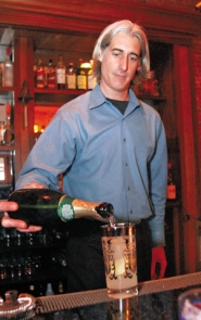 by: KATIE HARTLEY, Echo's Timothy Krawczuk pours some sparkle into a French 75, named for a World War I-era cannon.