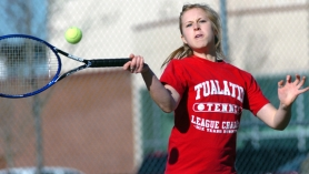 by: DAN BROOD, SUPER SHOT — Tualatin senior Marty Pellicano hits a forehand shot during play at Tuesday's Pacific Conference opener held at Tualatin High School.