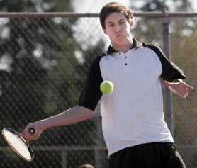 by: JONATHAN HOUSE, TOUGH TIGER — Tigard High School senior Anthony Breitenbach gets ready to hit the ball on his way to victory in No. 1 singles play in Tuesday's match.