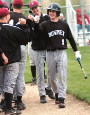 by: DAN BROOD, SLUGGING SAM — Sherwood senior Sam Karpeles (9), shown here after hitting a home run at Liberty last year, is one of the top returnees for the Bowmen.