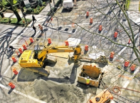 by: JIM CLARK, Workers do emergency sewer repair on Southwest Market Street and Second Avenue, proof that even sewers blocks from the light rail project have problems.