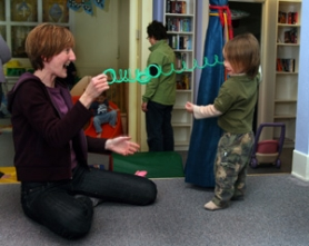 by: L.E. BASKOW, Karen Hery and Castle Pair, 2, take a Slinky to its limits at the play space and community center Hery helped create inside Sunnyside Methodist Church. Members can help themselves to clothes, toys and supplies, leaving their own items for others to take.