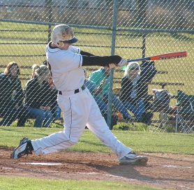 by: John Brewington, St. Helens' Matt Lokken takes a mighty swing during a game with Hilhi last week. The Lions handily beat the Spartans in their first two meetings, but lost the final outing.