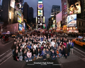 by: Photo courtesy of groupphotos.com, The Gresham High School choir poses in Times Square during their New York trip.