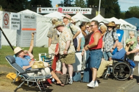 by: File photo, Jazz festival-goers line up to get into the event last year.