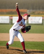 by: Chase Allgood, Forest Grove junior Aaron Huson throws a pitch during last Tuesday's game.