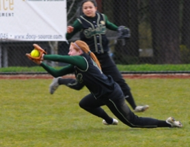 by: Vern Uyetake, West Linn right fielder Taylor Brooke makes a diving catch in the bottom of the fourth inning of last Friday's game against Lakeridge.The catch came on a line drive by the Pacers' Natalie Rose to lead off the inning. West Linn's defense was solid all afternoon but a two-out RBI single in the second inning was all the offense Lakeridge would need.