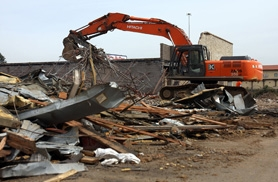 by: Jaime Valdez, MINED FOR COPPER — The former Room by Room Home Furnishings building in Tualatin was demolished last week because theives had stripped the building of its copper wiring and piping, making it economically unfeasible to repair the building.