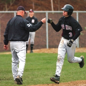 by: DAN BROOD, GOOD JOB — Sherwood coach Jon Strohmaier (left) congratulates Bowmen junior Zach Spencer following his fifth-inning home run in the 17-10 win over Liberty.