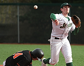 by: MILES VANCE, TURN IT — Jesuit senior second baseman Aidan Milstead tries to turn a double play with Beaverton's Taylor Noyer bearing down in the fourth inning of his team's 2-1 eight-inning victory on Tuesday at Jesuit High School.
