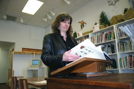 by: Garth Guibord, Katie Murphy, program coordinator at the Sandy Public Library, double-checks the information for a scavenger hunt that will be part of National Library Week, starting Sunday, April 13.