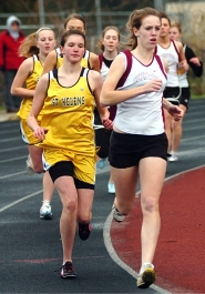 by: DAN BROOD, ON THE RUN — Sherwood junior Kristin Oenning (right) will compete in the distances and the high jump.
