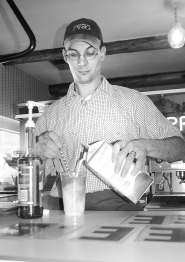 by: garth guibord, Tim Chesnut mixes up one of his special Italian sodas at his new Rhododendron restaurant, Good Times.