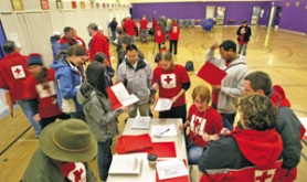 by:  L.E. BASKOW, Red Cross workers gather last week at Humboldt Elementary School to fan out and knock on some 1,600 doors in the neighborhood and talk about fire and disaster prevention.