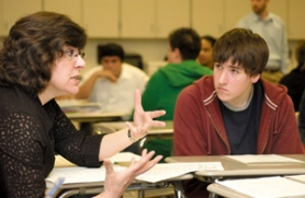 by: John Klicker, Reynolds High School student James Vigil, 17, listens as Cathy Sherick, special projects director for Police Activities League, conducts a group session on Peer Court with students in the Legal Studies class at Reynolds High School on Tuesday April, 8.
