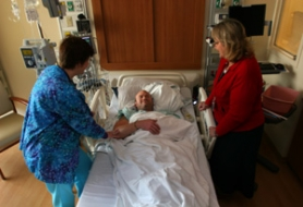 by: L.E. BASKOW, Nurses Lindi Goins (left) and Lee Martin check in on patient Michael Heinrich, who's noticed the difference between Providence's old cancer facility and the new one that opened in February — with design help from Goins and Martin.