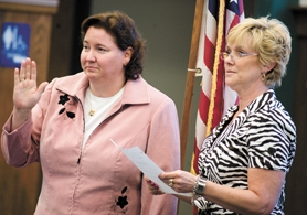 by: Chase Allgood, Forest Grove School Board chairwoman Dawn Pratt (right) administers the oath of office to Alisa Hampton, who was selected from three candidates to replace Shawn Vilhauer in Position 3. Her term began Monday night and extends through June 2009.