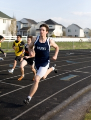 by: Chase Allgood, Banks senior Brad Markham surges ahead of the field during the 800 meter run last Thursday against Scappoose.