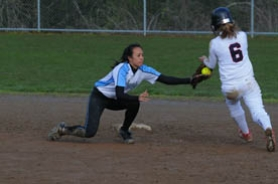 by: Vern Uyetake, Lakeridge's Chelsea Canlas puts a tag on Lake Oswego's Molly Pyle  during the first of a pair of Pacer victories. Below, Lake Oswego pitcher Taylor Hemzacek prepares to fire a ball toward the plate.