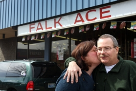 by: Jaime Valdez, Debbie Hessick kisses her husband Paul during a recent visit to the family-owned Falk Ace Hardware store in Beaverton.