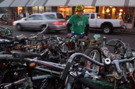 by: KATIE HARTLEY, Greg Lavender tries to find a spot on the crowded bike rack after bike enthusiasts flocked to the theater.