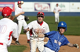 by: MILES VANCE, IN TROUBLE — Westview shortstop Kyle Larson (center) tosses the ball to first baseman Ryan Creitz as they chase down Aloha's Skylar Card in the second inning of Westview's 5-3 home win over the Warriors.