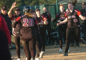 by: DAN BROOD, WAY TO GO — Tualatin senior Suzanna Espinoza (20) is congratulated by her teammates after she drove in the winning run in the Wolves' eight-inning win over Tigard.