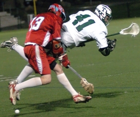 by: DAN BROOD, STICK WITH IT — Tigard's Andrew Cox (41) battles South Salem's Alex Leonard for the ball in Friday's match. The Tigers won 11-10.