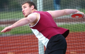by: DAN BROOD, THE WIND-UP — Tualatin High School senior Dennis Ranck gets ready to let the discus fly during last week's Pacific Conference dual meet with Canby.