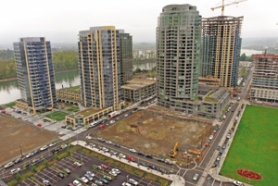 by: L.E. BASKOW, Per-unit development charges help fund roads and parks in the new South Waterfront neighborhood.