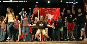 "by: Jaime Valdez, CUE THE SCREAMS — Brendan Bixel, center, along with other cast members rehearse for Hazelbrook Middle School's production of Disney's ""High School Musical."""