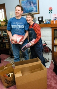 by: John Klicker, Jeff Anderson poses with an excited and grateful Becky Coleman, director and founder of My Sister's House, after he delivered half of the $3,248.22 shopping spree load, mostly in the form of meats and cheeses,